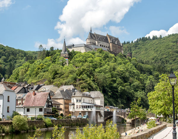 The fairytale Château de Vianden as seen from the town Architecture Architecture Building Exterior Built Structure Castle Château City Cloud - Sky Day Europe Green Color Growth Landscape Luxemburg Luxmebourg Mountain Nature No People Outdoors Sky Travel Tree Vianden Vianden Castle Water First Eyeem Photo The Great Outdoors - 2017 EyeEm Awards EyeEmNewHere Live For The Story The Great Outdoors - 2017 EyeEm Awards