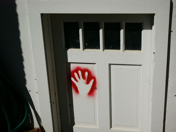 Door Graphitti Hand Print Harsh Lighting Leave A Mark Leave Your Mark No People Red Red Paint Spray Paint Hand Unkown Meaning Vandalism White Hand Window