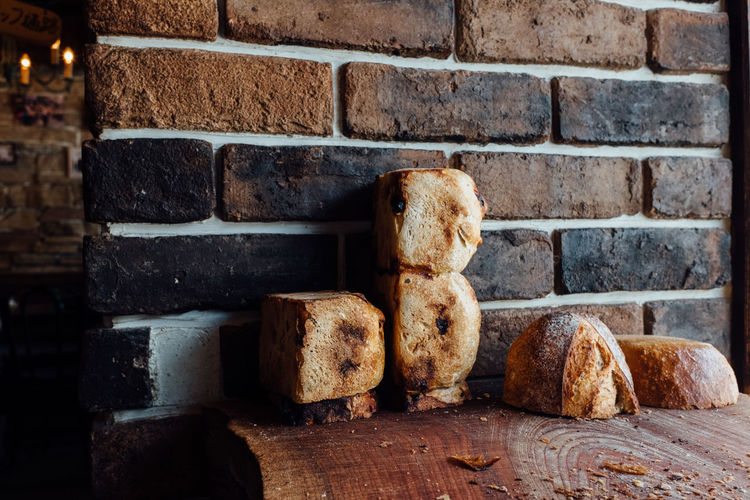 Handmade Freshness SLICE Food Photography Bake Bakery Bakery Cafe Bread Close-up Day Food Food And Drink Healthy Eating Loaf Of Bread No People Wooden Table Bread Crumbs Brick Wall