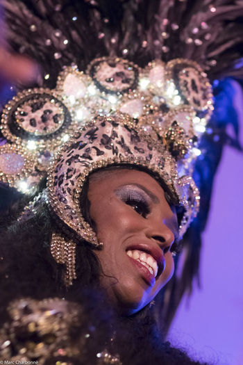 Close-up of smiling young woman wearing headwear during carnival