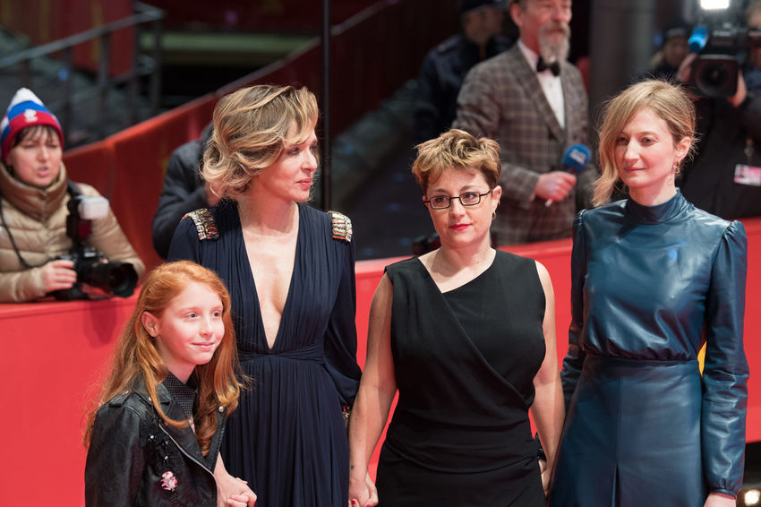 Berlin, Germany - February 18, 2018: Actresses Alba Rohrwacher, Valeria Golino, Sara Casu and director Laura Bispuri pose on red carpet at 'Daughter of Mine' (Figlia Mia) premiere at 68th Berlinale 2018 Alba Rohrwacher Film Festival Premiere Valeria Golino Actress Arts Culture And Entertainment Berlinale Berlinale 2018 Berlinale Festival Berlinale2018 Berlinale68 Entertainment Entertainment Event Italian Laura Bispuri Medium Group Of People People Posing Posing For The Camera Red Carpet Red Carpet Event Sara Casu Smiling Standing Women