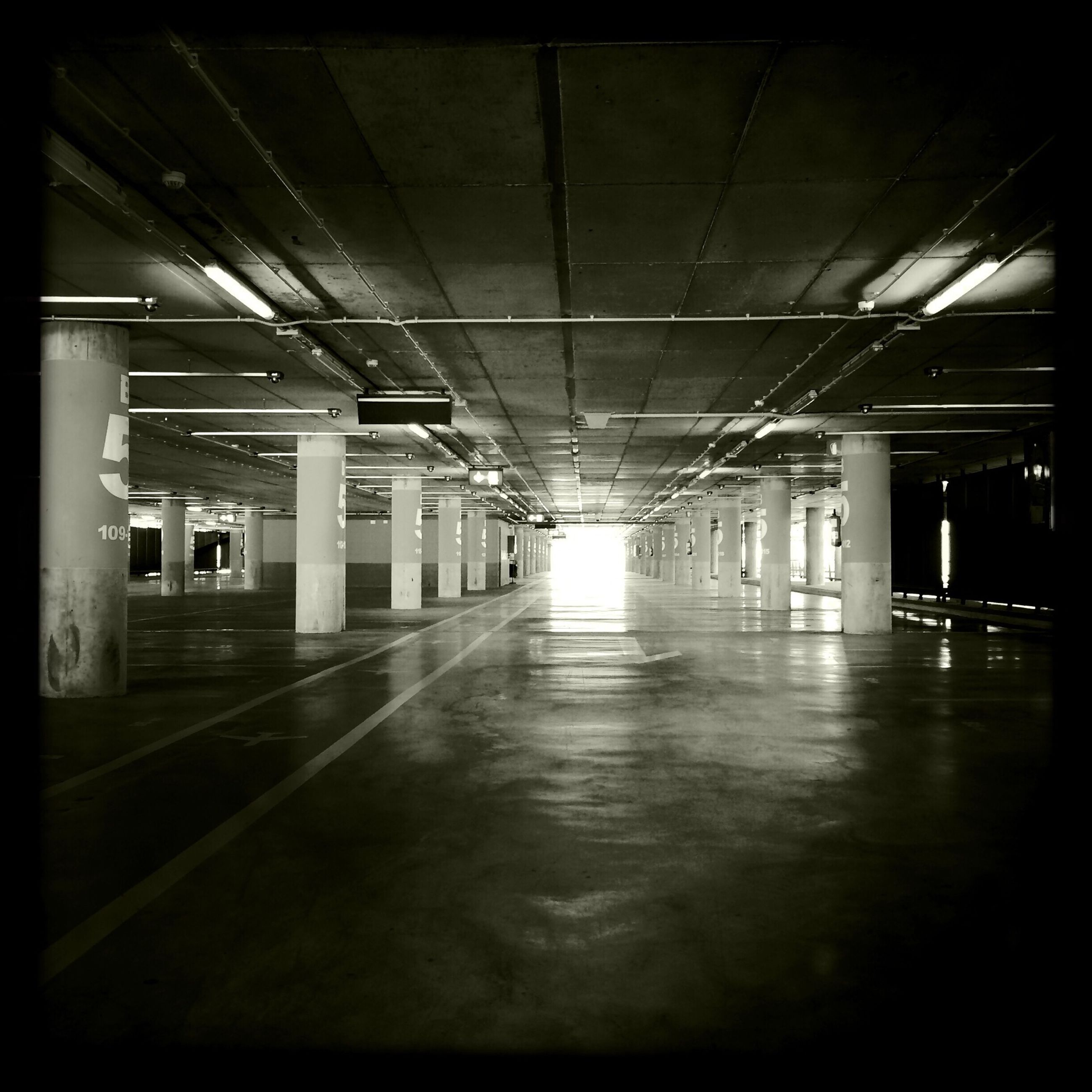 indoors, ceiling, architecture, built structure, the way forward, illuminated, empty, corridor, transportation, diminishing perspective, interior, flooring, absence, transfer print, architectural column, lighting equipment, long, auto post production filter, narrow, column