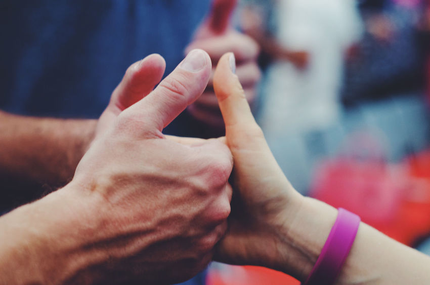Two people holding hands and fingers. Meeting Workshop Youth Of Today Adult Bonding Close Up Close-up Connection Day Fingers Friendship Game Group Of People Holding Human Body Part Human Hand Inclusion Love People Real People Togetherness Unity Volunteer Young Adult