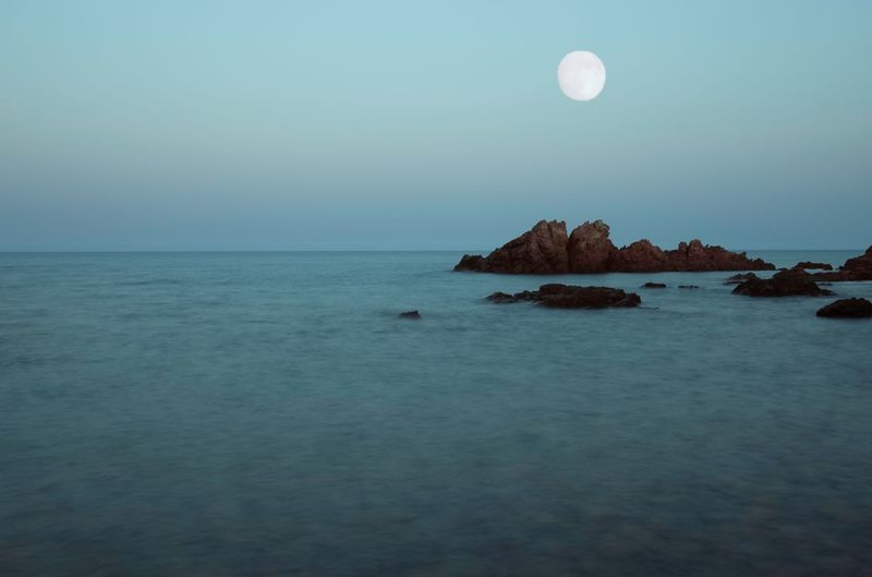 Spend a night with you is like flying in the ocean 💑 This picture i took while wandering through wild places with my love near Gairo, Sardegna. Full Moon Fest The Week on EyeEm Italy Sardegna Seascape Landscape Water Sea Sky Scenics - Nature Moon Beauty In Nature Tranquil Scene Tranquility Nature Horizon Horizon Over Water Land Full Moon No People Rock Idyllic Rock - Object Clear Sky Blue Outdoors