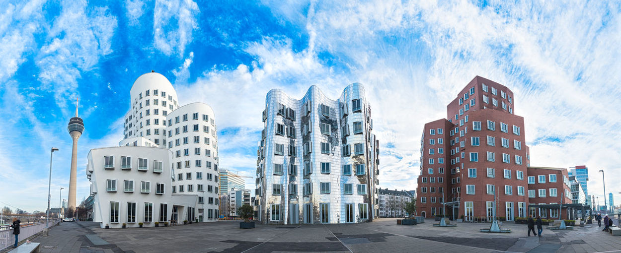DUESSELDORF, GERMANY - JANUARY 20, 2017: The famous Ghery-Buildings in the New Media Harbor shine against the vivid blue sky - Grand High Resolution Hyperrealistic Panorama 50 Megapixel Adapted To The City Architektur Blau Blue Blue Sky Broadcasting City Cityscape Cloud Colorful D#Dorf Day Düsseldorf Gherkin High Resolution Hypereaistic Hyperrealism Photography Landscape Lifestyles Medienhafen New Media Harbor Panorama Touristic Attratio Urban EyeEmNewHere