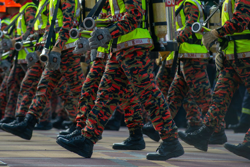 Armed Forces Army Soldier Camouflage Clothing Clothing Crowd Day Government Group Of People Human Limb Large Group Of People Low Section Marching Men Military Military Uniform Outdoors Parade Protection Real People Responsibility Safety Standing Togetherness Uniform
