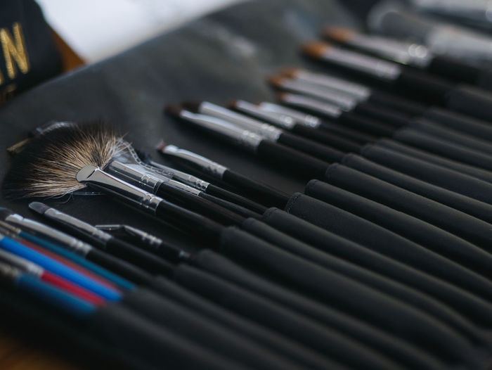 Close-up of various brushes on table
