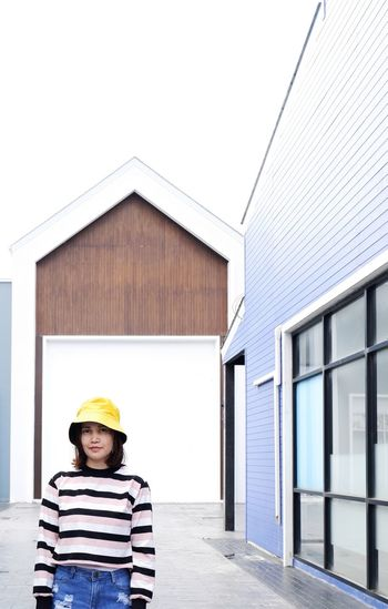 Man standing outside house against building