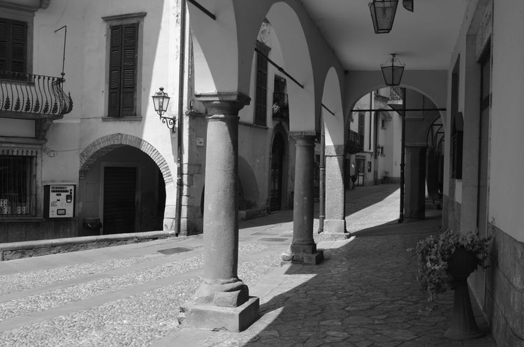 Italia Pisogne Arcade Arch Architectural Column Architecture Black And White Built Structure City Italy Lago Iseo No People Shadow Street