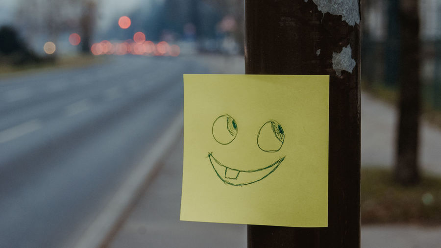 SONY DSC Focus On Foreground Anthropomorphic Smiley Face No People Yellow Communication Sign Road Drawing - Art Product Creativity Close-up Representation Paper Day Anthropomorphic Face Art And Craft Emotion Pole Face Note Heart Shape Outdoors Sarajevo Bosnia And Herzegovina Long Exposure