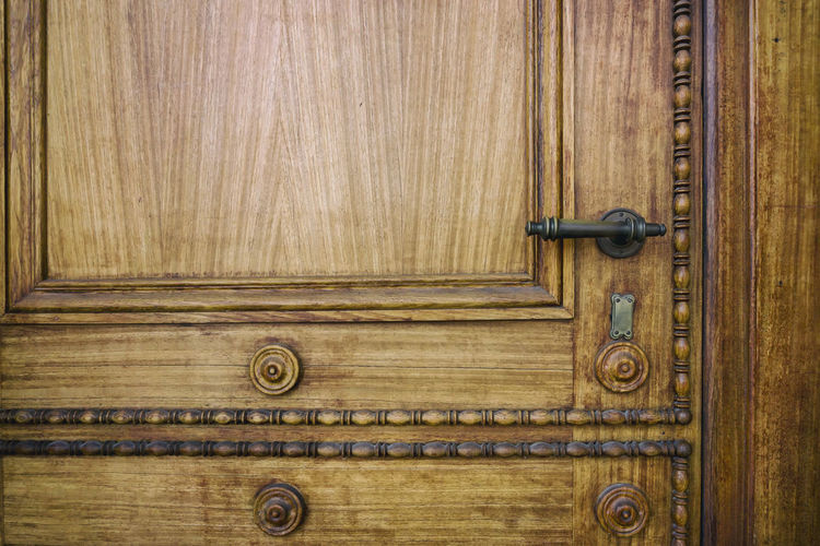 Close-up of carved ornaments on wooden house door Berlin Germany 🇩🇪 Deutschland Horizontal Carvings In Wood Close-up Color Image House Door No People Ornaments Outdoors Wood - Material