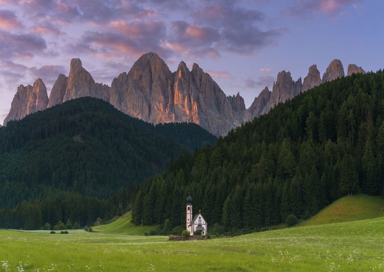 Santa Magdalena church with Dolomite mountains on the background Beautiful Church Dolomites Grass Nature Panorama Panoramic Trees View Alpenglow Alps Best  Bolzano Clouds Dolomiti Italian Italian Alps Italy Landscape Mountains Peaceful Religion Santa Magdalena Sunrise Sunset