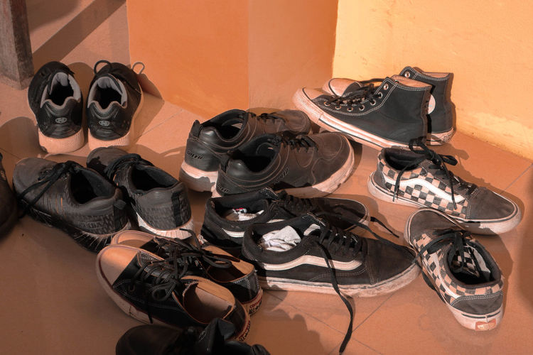 High angle view of shoes on floor against wall