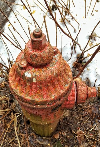Old fire hydrant with wonderful peeling paint and visually stunning aesthetic quality Red Fire Hydrant Deterioration Rusty Peeling Paint Old Cold Winter Close-up Textures And Surfaces Metal Painted Pattern Pieces Pattern, Texture, Shape And Form
