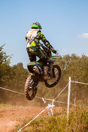 Motocross rider mid jump. Action Action Shot  Bike Dust Dusty Extreme Sports Helmet Jumping Motocross Motorbike Motorcycle Motorcycle Motorcycles Motorsport Riding Scramble Scrambler Sport Sport Photographer Sports Sports Photography Sportsphotography Stunt Summer Summertime