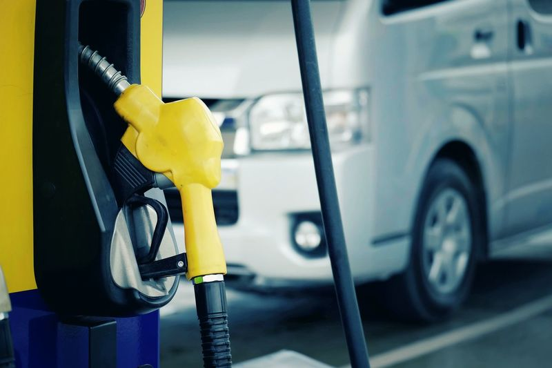 Nozzle fuel for fill oil into car tank at gas station Technology Environment Transportation Transport Energy Power Gas Benzine Expensive Petroleum Gasoline Investment Fuel Petrol Cost Business Save Oil Vehicle Station Development Industry Safety Hose Pump