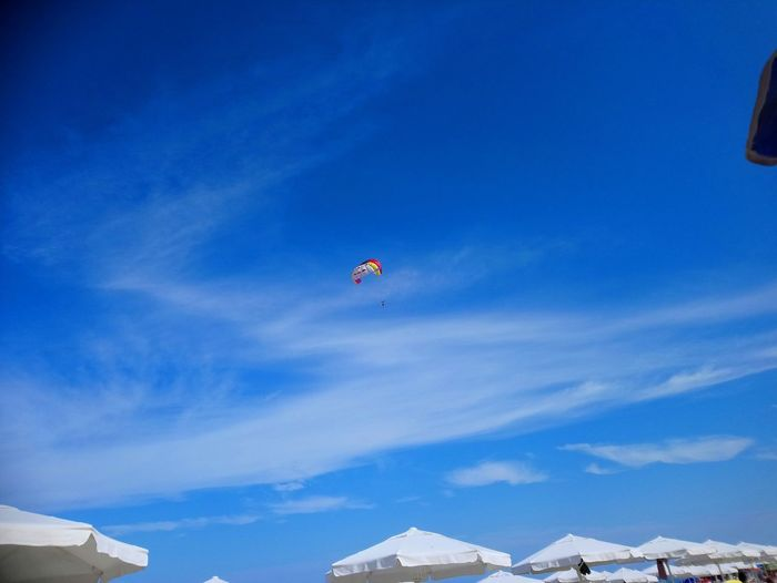 Flying Mountain Blue Arts Culture And Entertainment Sky Architecture Parachute Paragliding Extreme Sports Stunt Person Hot Air Balloon Gliding Parasailing Water Sport