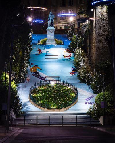Illuminated christmas tree by swimming pool at night