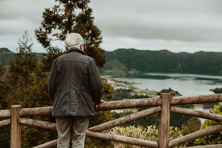 Azores Azores, S. Miguel Rear View Contemplation Observing Realxing Real People One Person Water Railing Senior Adult Lifestyles Adult Tranquility Tranquil Scene Looking At View Scenics - Nature Outdoors Nature Leisure Activity Sky Day Beauty In Nature