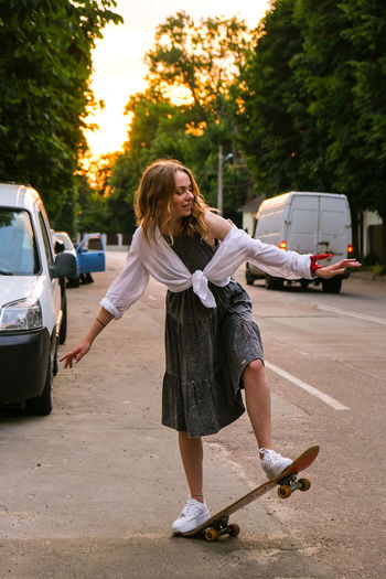 Full length of senior woman on road in city