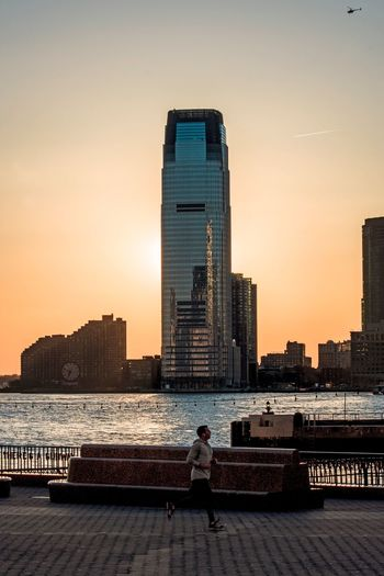 Jogging NYC Photography NYC LIFE ♥ Battery Park Sunset Silhouettes Sunset_collection Sunset Built Structure Architecture Building Exterior Sky City Sunset Building Urban Skyline Outdoors Waterfront Travel Destinations Cityscape Skyscraper Tall - High Water Modern Nature