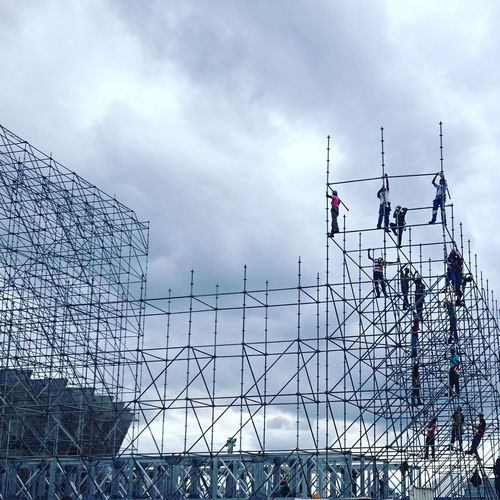 People on scaffolding at construction site