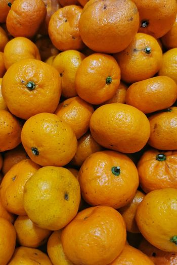 High angle view of oranges for sale in market