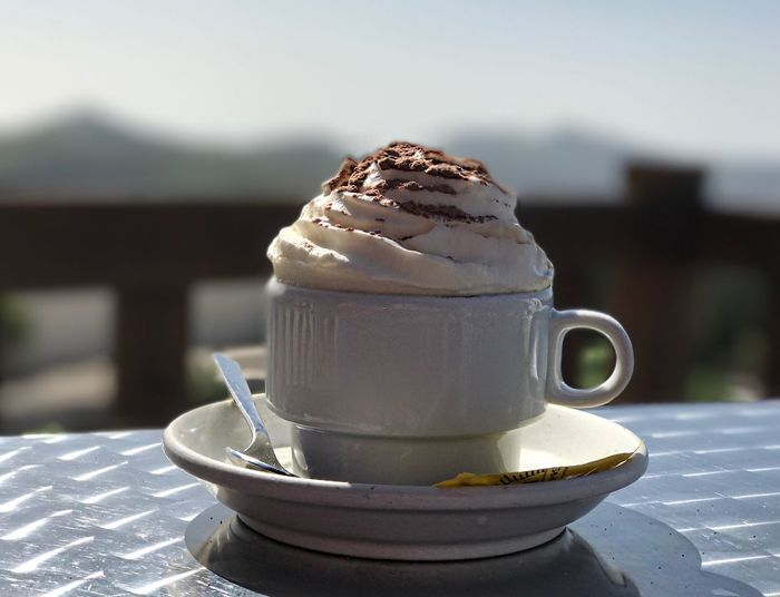Close-Up Of Coffee With Whipped Cream On Table