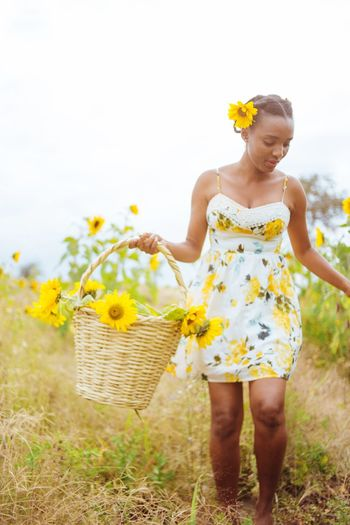 Plant One Person Flower Flowering Plant Basket Nature Yellow Front View Standing Lifestyles Women Freshness Sky
