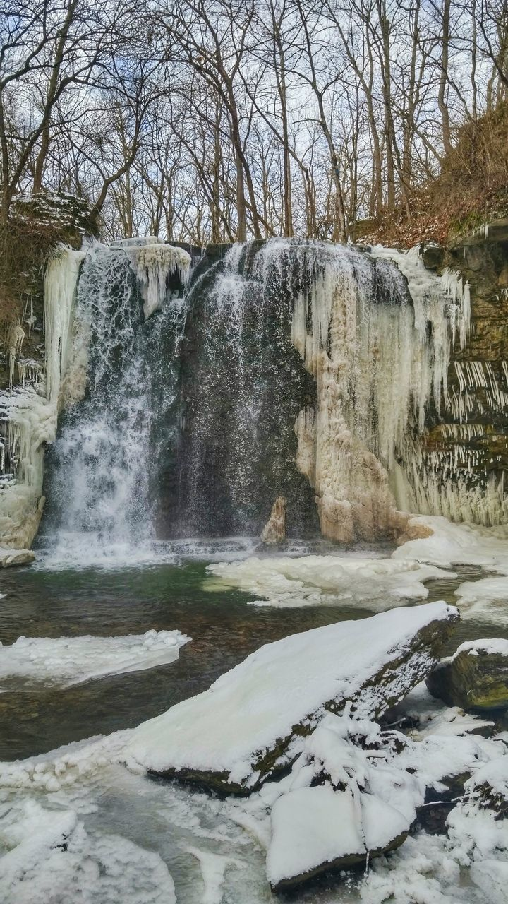 motion, flowing water, water, waterfall, nature, long exposure, beauty in nature, outdoors, scenics, bare tree, no people, tree, day, winter, tranquility, snow, cold temperature, sky