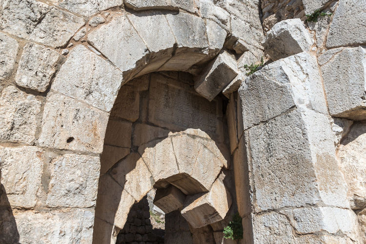 Fragment of the north eastern entrance to the Nimrod Fortress located in Upper Galilee in northern Israel on the border with Lebanon. Israel Nimrod Fortress Saladin Beybars Crusaders Ayubids Mamluks Assassins History Heritage Castle Travel Destinations National Park Tourist Attraction  Hill Stone Wall Entrance Gate Tunnel Old Ancient Loophole Medieval Architecture Ruins Protection
