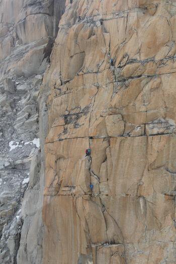 View Of Man Climbing On Rock