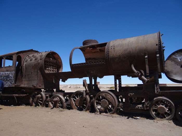 Uyuni Train Cemetry Bolivia Rust Uyuni Blue Clear Sky Copy Space Damaged Day Deterioration Field Land Land Vehicle Locomotive Metal Mode Of Transportation Nature No People Outdoors Rail Transportation Rusty Scrap Scrapyard Sky Sunlight Train Train - Vehicle Transportation Wheel