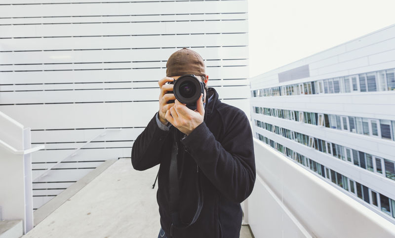 photographer takes a picture from his self in a mirror. Camera Mirror Take Photos Architecture Building Exterior Camera - Photographic Equipment Day Focus Hipster Holding Men One Person Outdoors People Photographer Photographing Photography Photography Themes Professional Real People Selfie Standing Take Picture Technology Young Adult