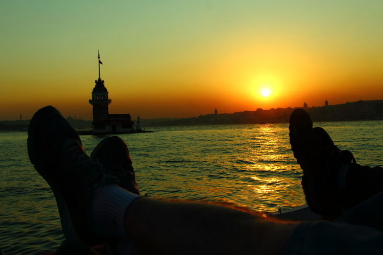 Sunset Silhouette Sea City Two People Outdoors People Togetherness Human Body Part Sky Water Tranquil Scene Sunlight Adults Only Statue Beauty In Nature Uskadar Turkey