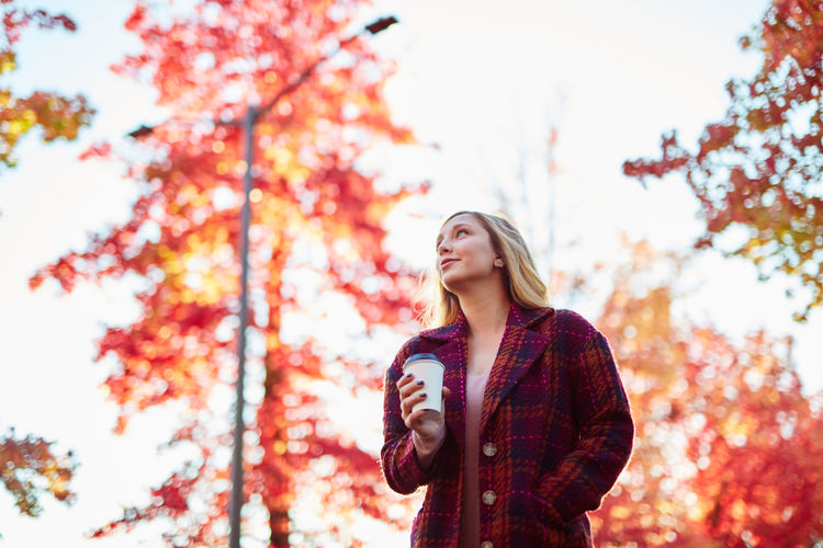 Autumn Beautiful Woman Beauty In Nature Casual Clothing Close-up Day Focus On Foreground Front View Leaf Leisure Activity Lifestyles Low Angle View Nature One Person Outdoors Park - Man Made Space People Real People Sky Smiling Standing Tree Young Adult Young Women