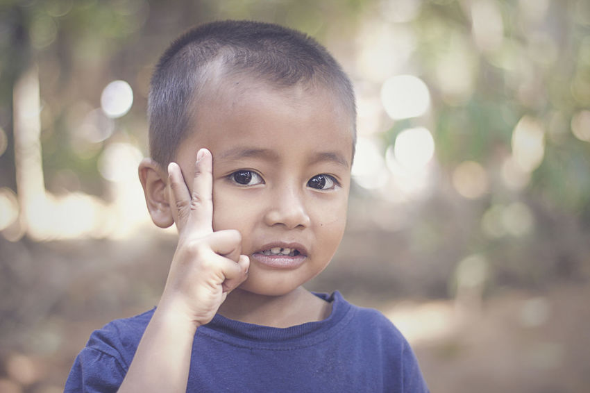 Ihsan INDONESIA Java Childhood Close-up Day Focus On Foreground Happiness Headshot Human Body Part Human Hand Innocence Javanese Looking At Camera One Person Outdoors People Portrait Real People Smiling
