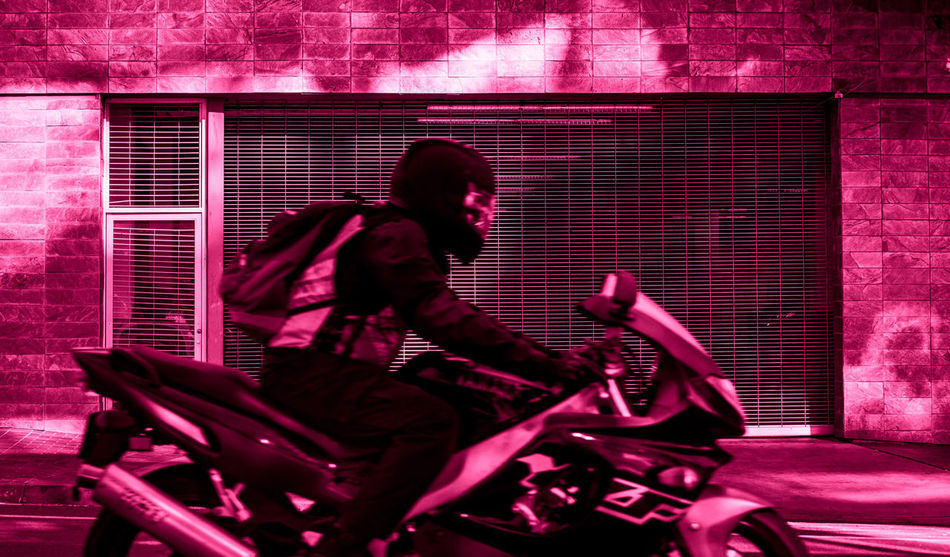 Motorcycle Adult Adults Only Architecture Built Structure Day Female Motorcyclists Full Length Lifestyles Motorcycle Insurance Motorcycle Safety One Person Outdoors People Pink Bike Pink Motorcycle Real People Ride Safety Side View Solo Pink Speed Sport Bikes Sport Motorcycle Transportation