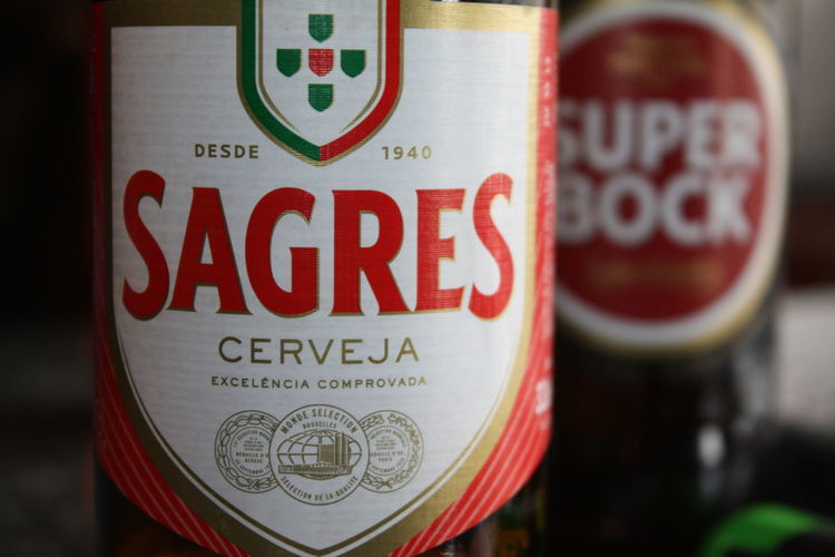 SAGRES vs. SUPER BOCK - Portuguese beer Close-up Focus On Foreground Drink Red Refreshment Food And Drink Alcohol Label Beer Capital Letter Beer - Alcohol Sagres Beer Super Bock Macro Photography Macro Canon Canonphotography Canon Eos  Amateurphotography Enjoying Life Fresh Thirsty
