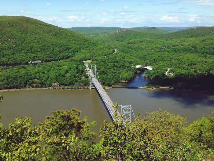 Aerial view of suspension bridge over river