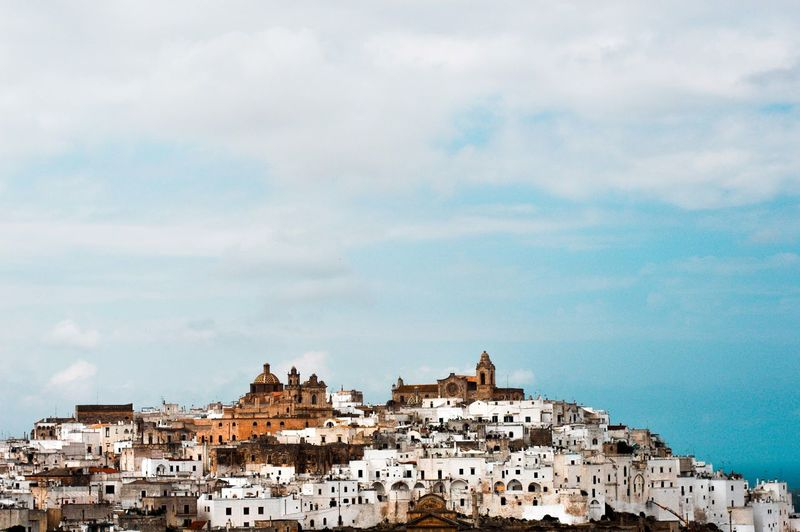 The city Ostuni on it's hill Building Exterior Architecture Building Built Structure City Sky Residential District Cloud - Sky Town Day House No People Outdoors Cityscape Land Travel Destinations TOWNSCAPE Panorama City Italy Hill Ostuni Vacations Traveling