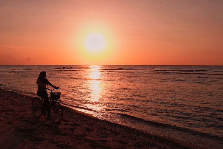 Gili Trawangan, Lombok, Indononesia. Sunset Sky Water Sport One Person Bicycle Orange Color Ride Sea Transportation Leisure Activity Lifestyles Riding Beauty In Nature Sun Activity Full Length Silhouette Horizon Over Water Outdoors EyeEm Best Shots EyeEm Selects Nature Beauty In Nature EyeEm Nature Lover My Best Photo