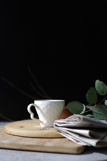 Good morning! Coffee and newspaper Morning Newspaper Coffee Food And Drink Indoors  Food Black Background No People Leaf Still Life Plant Part Table Drink Kitchen Utensil Close-up Freshness Nature Wood - Material Cup