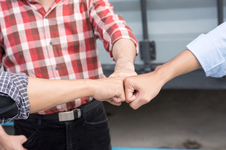 Friends giving fist bump
