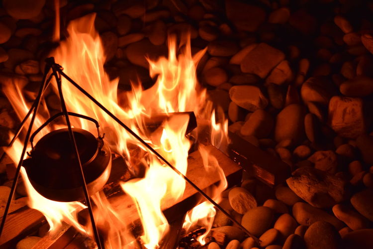 Beach Beachfire Beachfront Beachlife Beachphotography Burning Burning Coast Fire Flame Flame Flames Flames & Fire Kettle Night No People Outdoors Pebble Beach Pebbles Pebbles And Stones Tripod Warm Warmth Wood Wood - Material