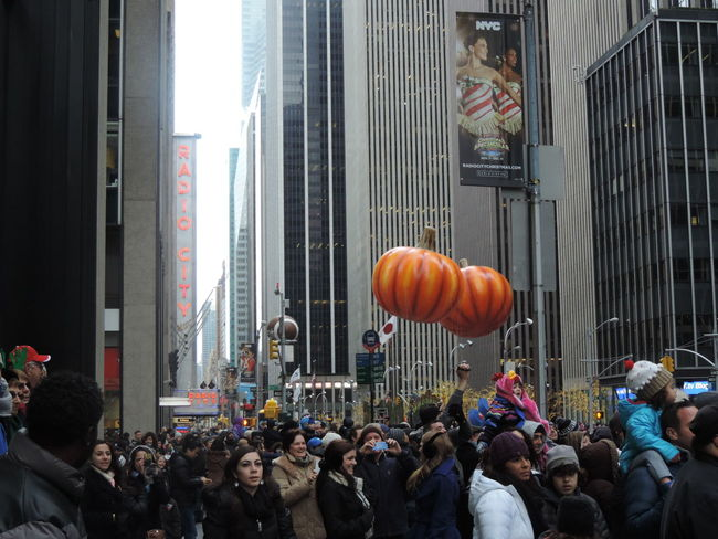 Thanksgiving Day parade in November 2014 6th Avenue Buildings City Crowds Floats New York New York City Parade Thanksgiving