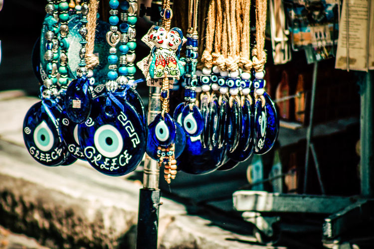 Close-up of good luck charm hanging for sale at market stall