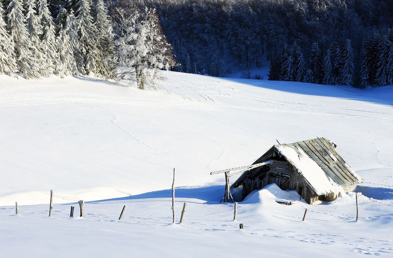 Scenic View Of Snow Field During Winter