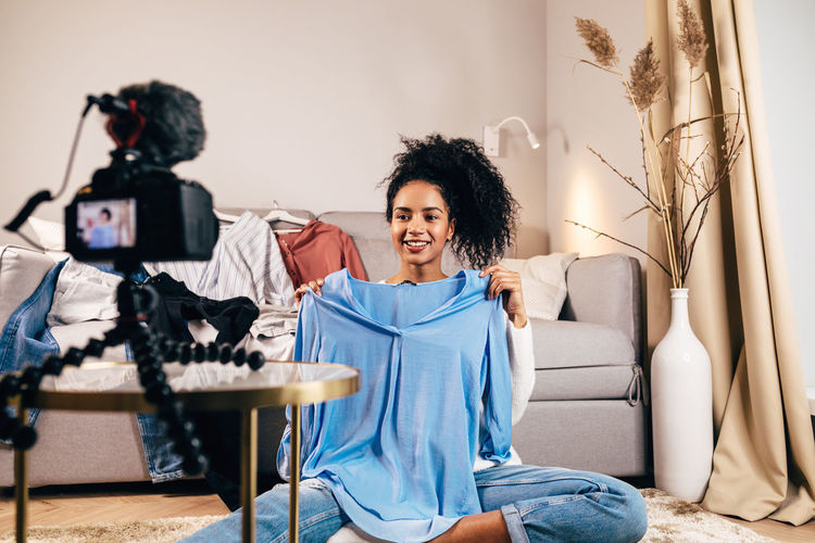 Vlogger Blogger Beauty One Person Happiness Indoors  Clothes African American Looking Streaming Live Living Room Cosmetics Record E-commerce Content Social Media Real People Lifestyles Young Woman