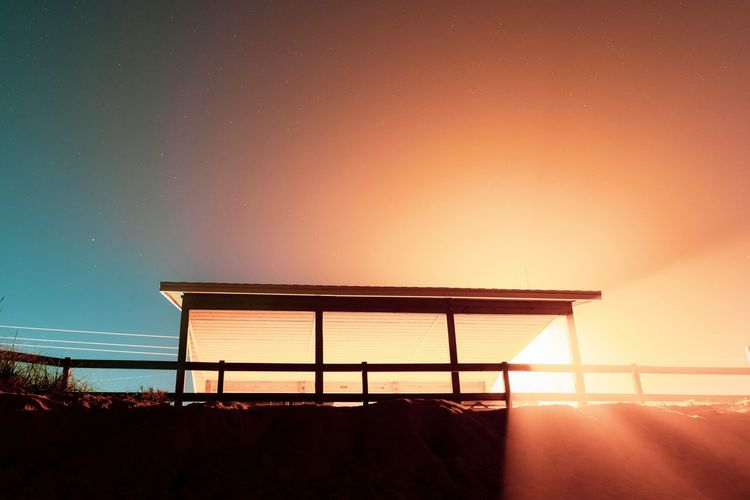 Silhouette built structure against sky during sunset